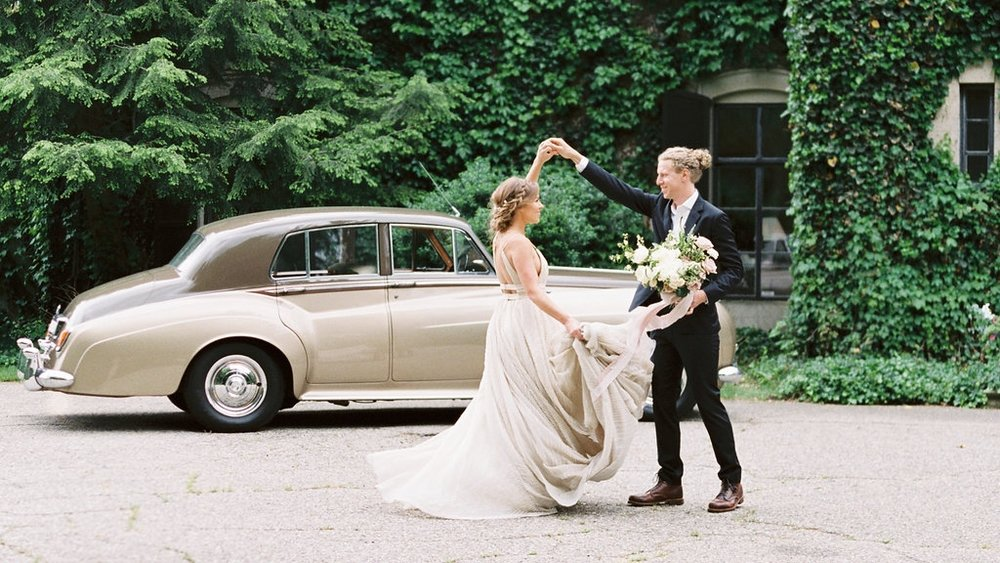 Fine art wedding inspiration — twirling in front of a beautiful english style venue and vintage car! Such a beautiful bride and groom www.blusheddesign.com