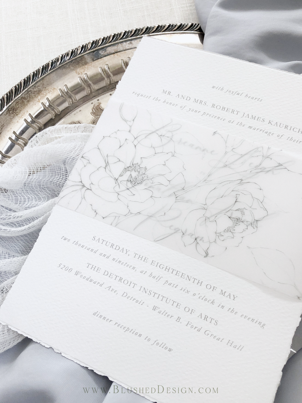Beautiful vellum wedding invitations with a delicate garden rose illustration on it. #fineartweddinginvitations #vellumweddinginvitations