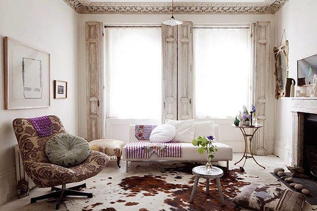 With so many things to love ❤️ in this living room, where do you start to recreate this look? Start with the neutral foundation like the wall color, the gorgeous antique shutters flanking the windows and the white sofa.  This allows you to build from here with texture, pattern, and color. With the right foundation #MoreisMore  #filthygorgeous #interiordesign #designandinspire #homedecorating #homedecor #look #love #pattern #texture #color #helpfultips #tipsfromFG