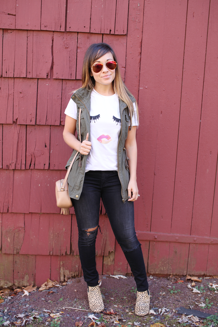 See how to style an oversized tee with ripped denim, and military vests as an accent piece from fashion blogger, Little Tree Vintage.