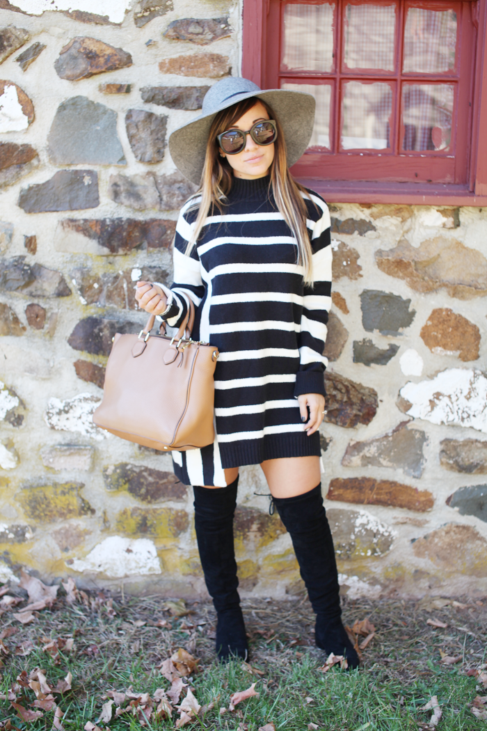 See how fashion, lifestyle, and beauty blogger Little Tree Vintage styles a sweater dress with over the knee boots for Fall.