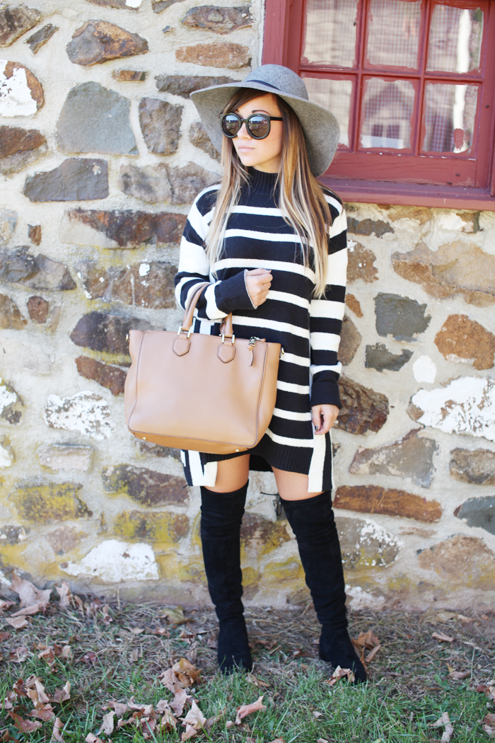 Check out how fashion, lifestyle, and beauty blogger Little Tree Vintage styles a sweater dress with over the knee boots for Fall.