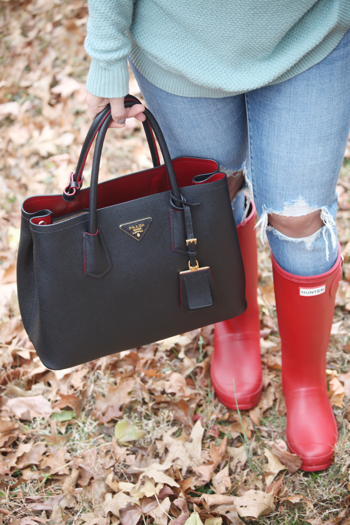 Red Hunter boots & a Prada bag! Check out how fashion, lifestyle, and beauty blogger Little Tree Vintage styles this cozy outfit for Fall and Winter.