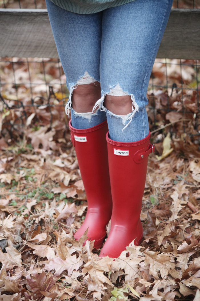 Blue Jeans and Red Hunter Boots! Blue jeans, soft sweaters, and red Hunter Boots. Check out how fashion, lifestyle, and beauty blogger Little Tree Vintage styles this cozy outfit for Fall and Winter.