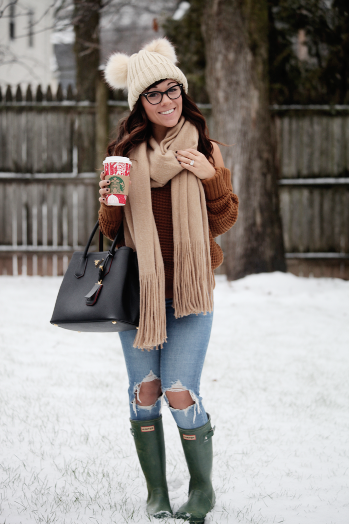 Blue jeans, comfy sweater, and a oversized neutral scarf pulls this cozy winter outfit together.