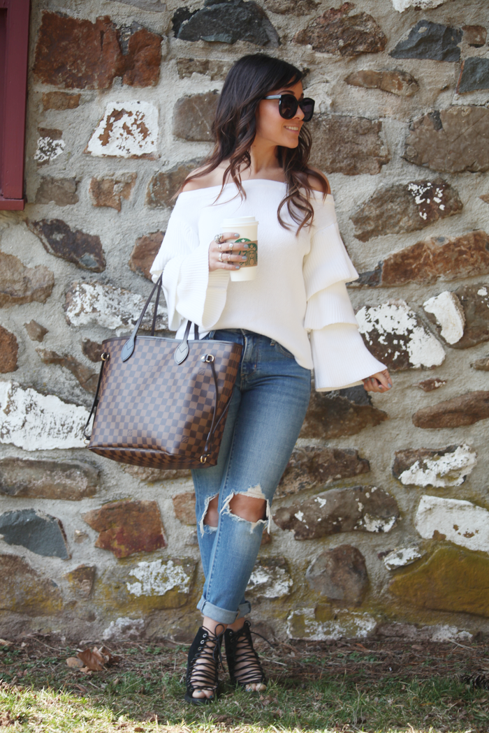 Learn how to style lace-up booties, a white ruffle top, and a ripped denim with fashion, lifestyle, and beauty blogger Little Tree Vintage.