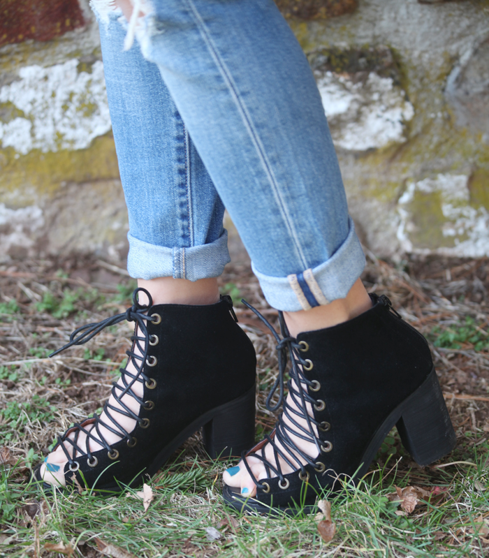 Lace-up booties with ripped denim.