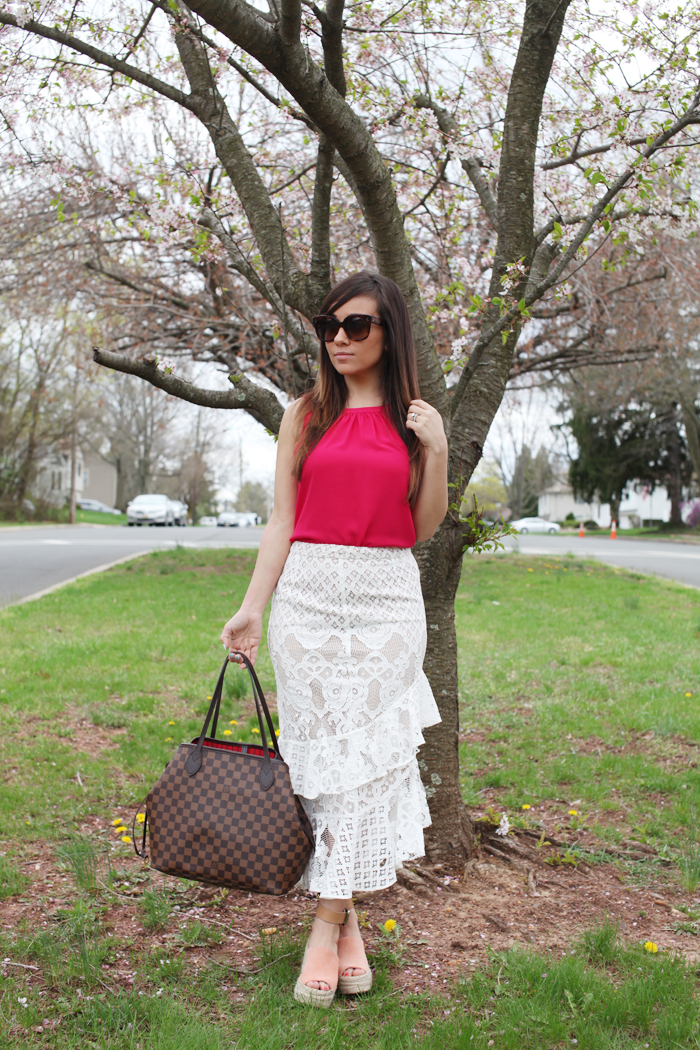 See how fashion, lifestyle, and beauty blogger Little Tree Vintage styles this lace skirt with a pop of color in pink for a top.