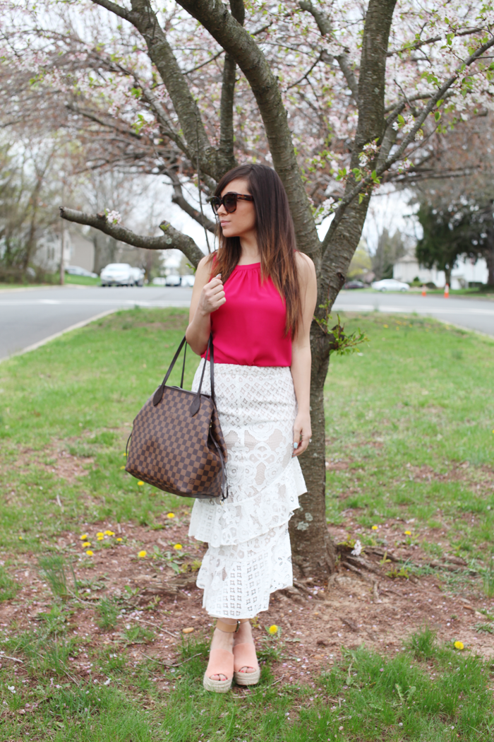 See how fashion, lifestyle, and beauty blogger Little Tree Vintage styles this lace skirt with a pop of color in pink, and espadrilles.