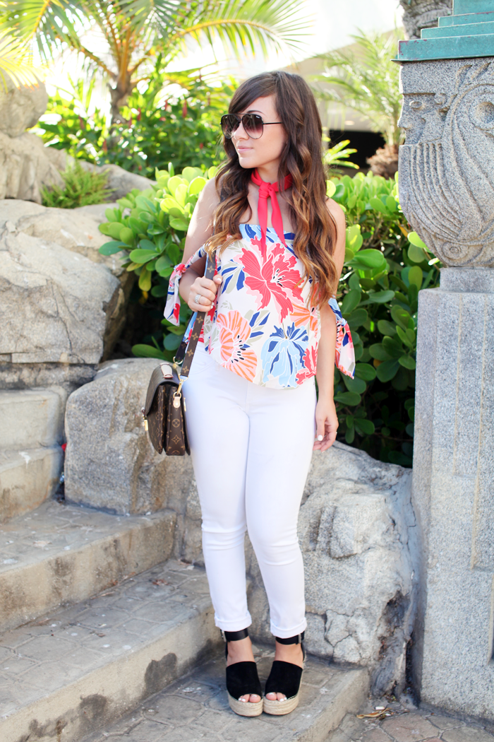 Check out how fashion, lifestyle, and beauty blogger Little Tree Vintage styles this patterned top with white denim.