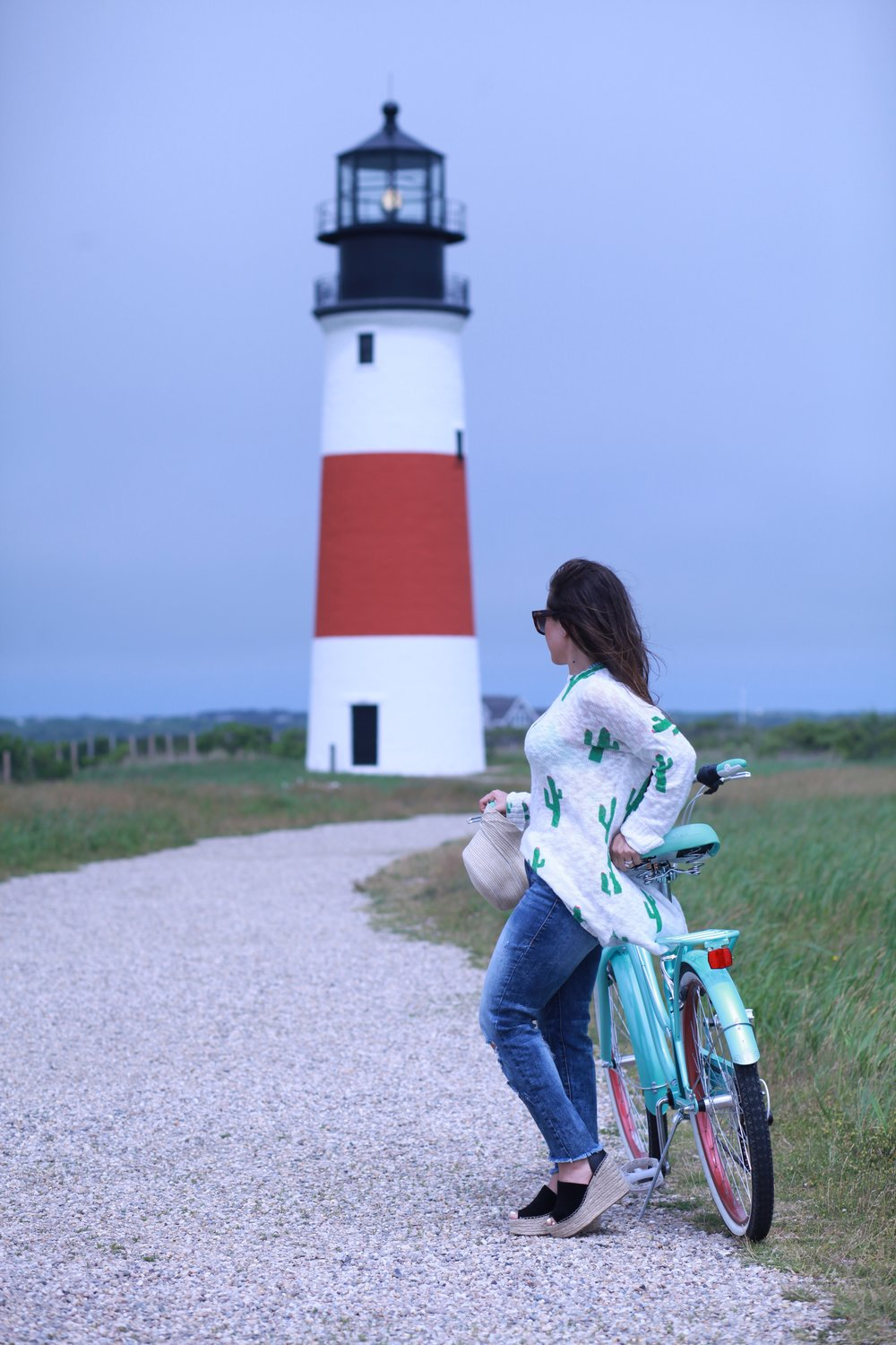 Fashion, lifestyle, and beauty blogger Little Tree Vintages shows what to wear while biking on an island during the Spring and Summer.