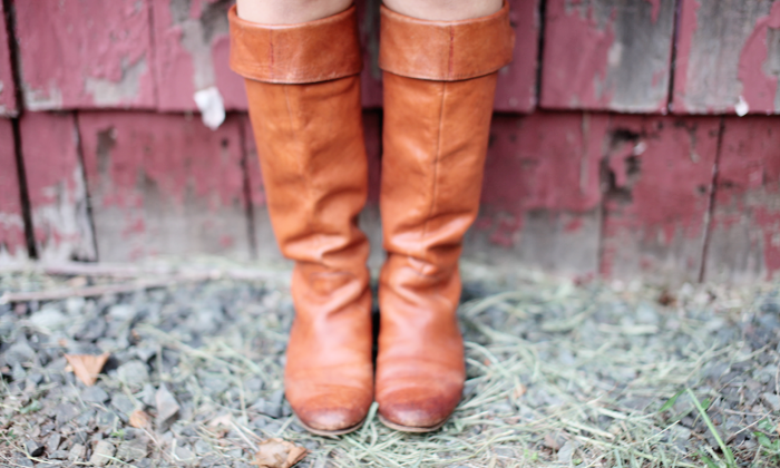 Knee high riding boots will help you style a dress and transition it for Fall.