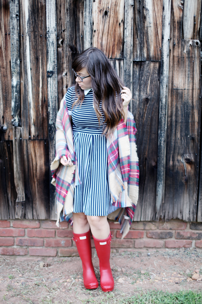 See how fashion, lifestyle, and beauty blogger Little Tree Vintage styles one dress two-ways for Fall by adding a plaid poncho and red Hunter Boots.