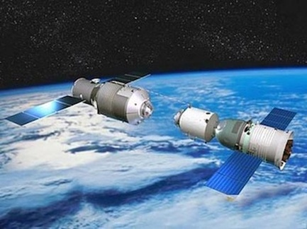 An artist's rendition of Tiangong 1, left, being visited by a Shenzhou. Three of these   spacecraft visited the space station over the course of two years. Image Credit: China   National Space Administration