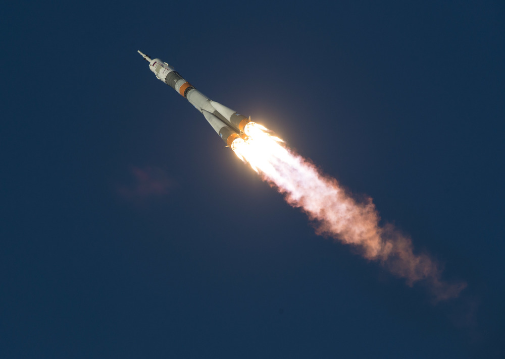 A Soyuz launches skyward. Photo Credit: NASA