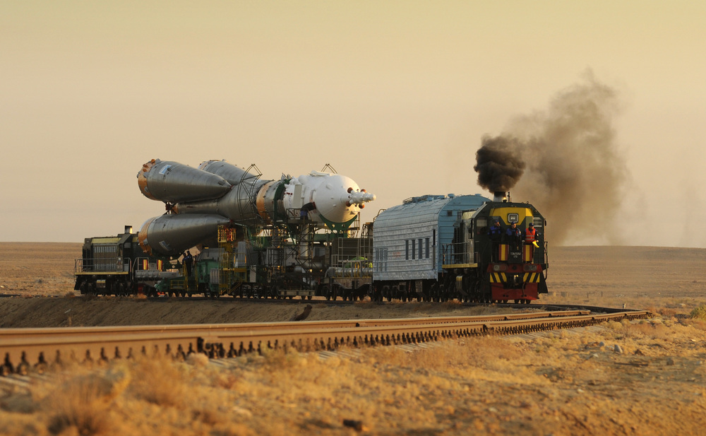 A train transports the Soyuz spacecraft and rocket to the launch pad at Baikonur Cosmodrome in Kazakhstan. Photo Credit: Bill Ingalls / NASA