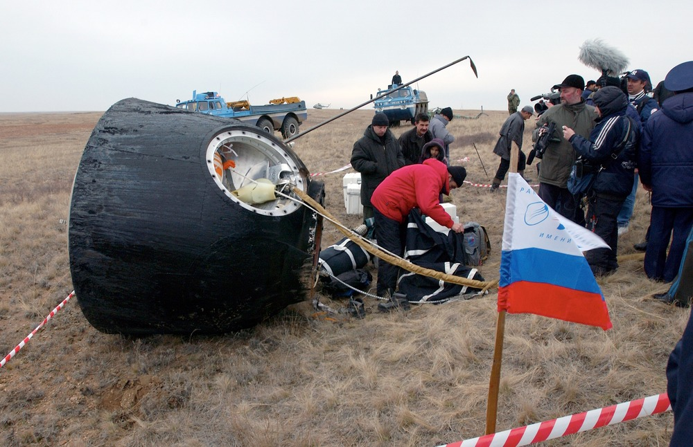 Crews of a Soyuz are extracted by ground crew after landing. Photo Credit: Bill Ingalls / NASA