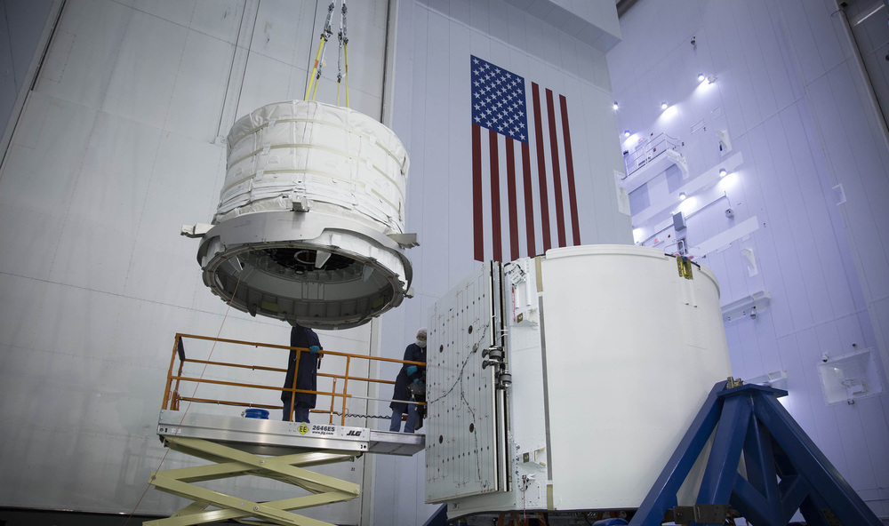 Engineers load unpressurized cargo into Dragon's Trunk prior to launch. Photo Credit: SpaceX