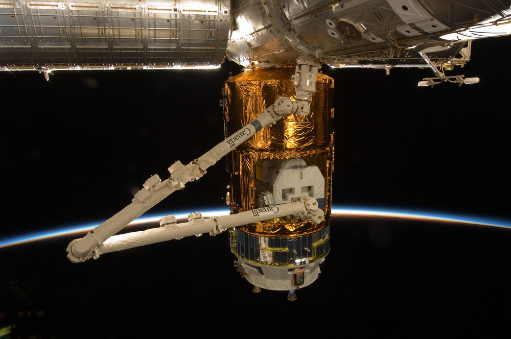 Canadarm2 extracts cargo from Kounotori's Unpressurized Logistics Carrier. Photo Credit: NASA