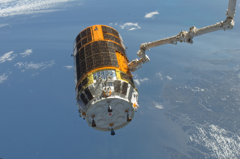 Canadarm2  positions the Kounotori for release after being loaded with trash. Photo Credit: NASA