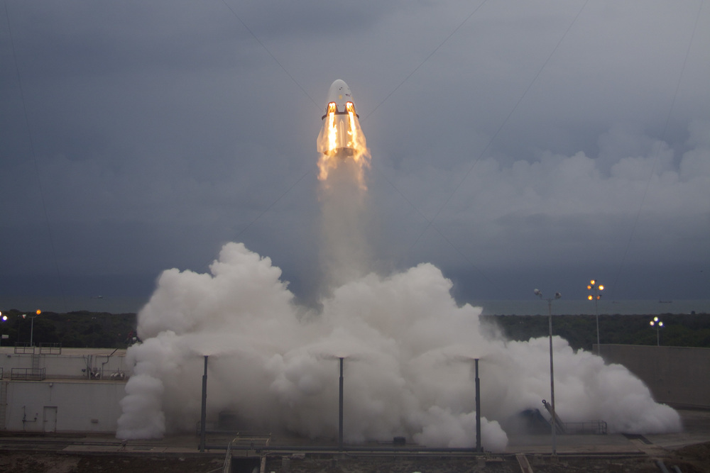 Crew Dragon flies skyward, testing the SuperDraco thrusters in the Pad Abort test on May 6, 2015. Photo Credit: SpaceX