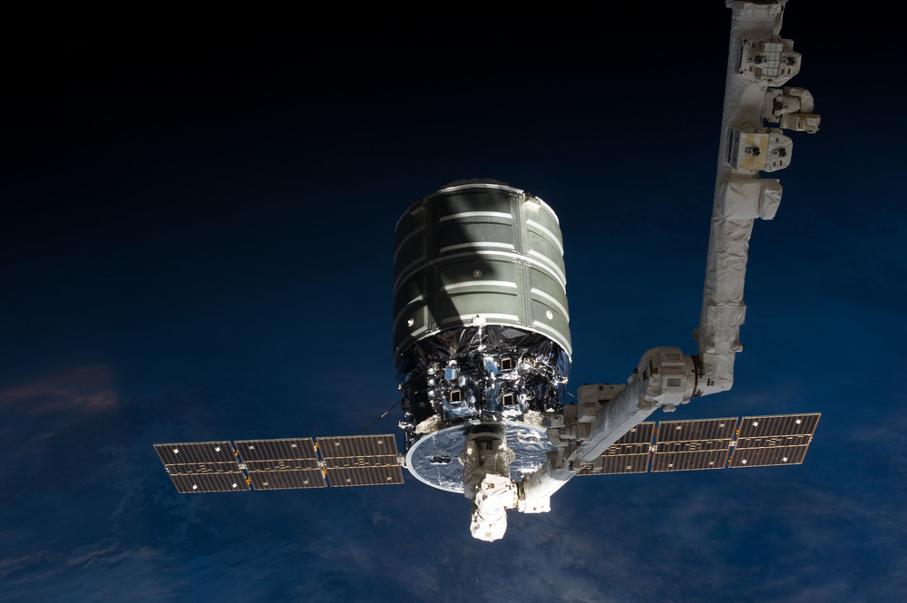 A first-generation Cygnus is grappled by  Canadarm2 . Photo Credit: NASA