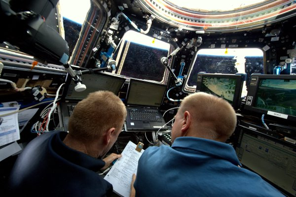 Astronauts control the robotic arm from the bay window-like Cupola. Photo Credit: NASA