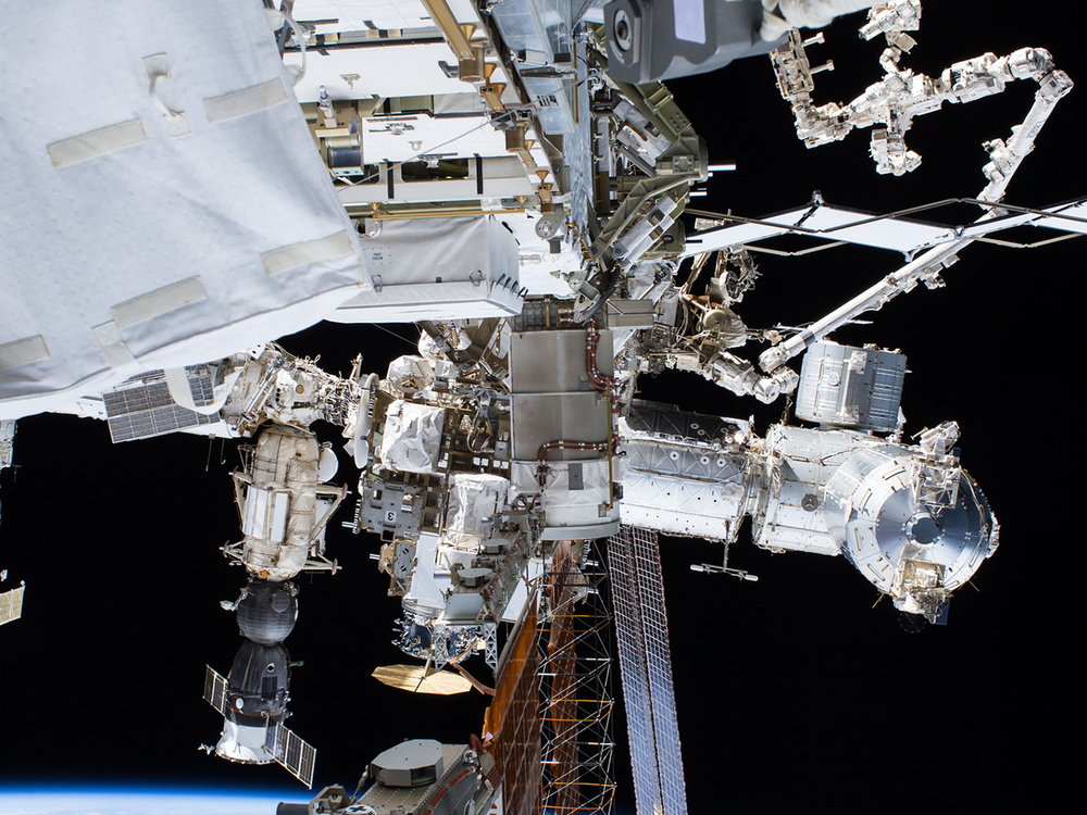 A spacewalking astronaut's view of the outpost. Cygnus can be seen near the center. Photo Credit: NASA