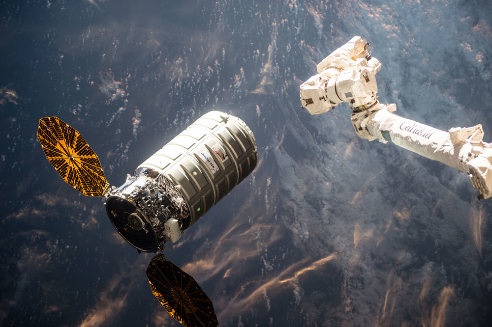 "Cygnus moments away from being ""grabbed"" by the space station's robotic arm. Photo Credit: NASA"