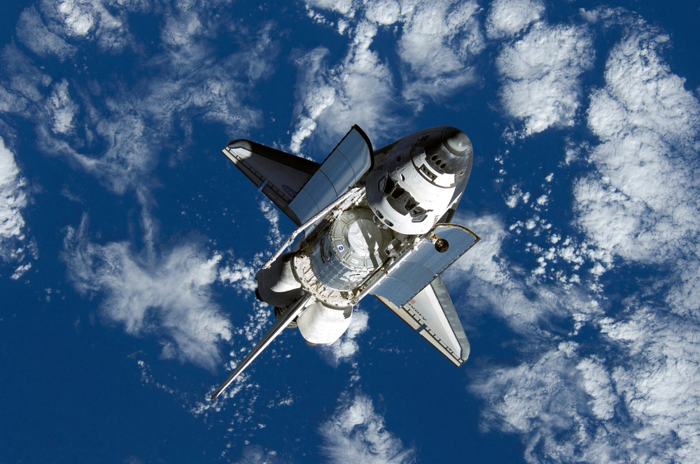 Space shuttle  Discovery  approaches the International Space Station with the  Harmony  Module in its payload bay. Photo Credit: NASA