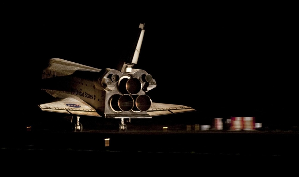 The final space shuttle,  Atlantis , lands at the Kennedy Space Center's Shuttle Landing Facility in on July 21, 2011. Photo Credit: NASA