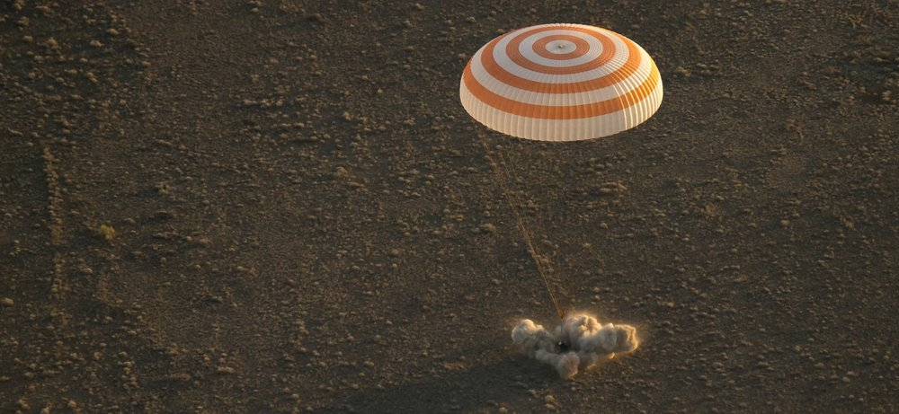 The Soft Landing engines fire to cushion the final meter of the descent. Photo Credit: Bill Ingalls / NASA