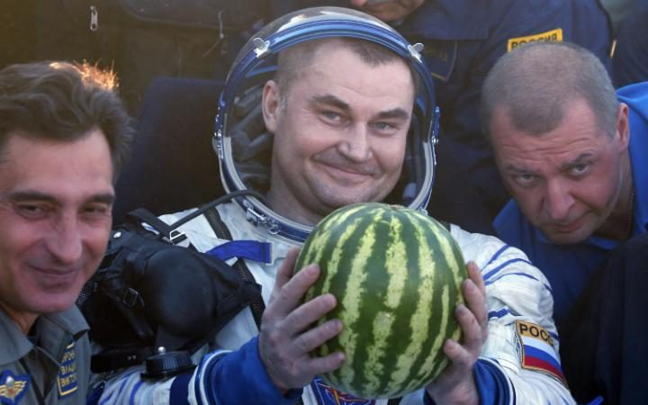 After jokingly asking for a watermelon, the ground team came through and presented Ovchinin with one. Photo Credit: Maxim Shipenkov / AP