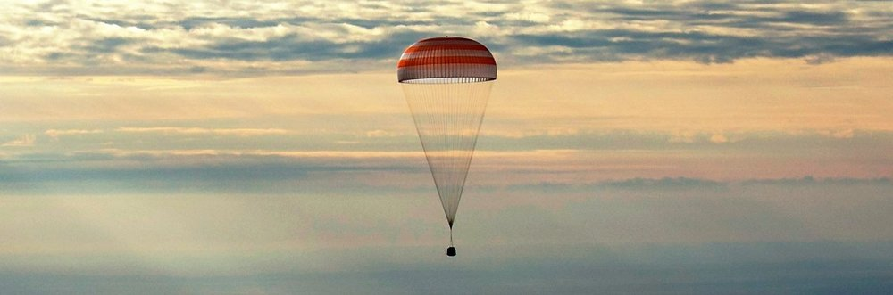 The Soyuz MS-01 capsule descends toward the ground over the Steppe of Kazakhstan. Photo Credit: Bill Ingalls / NASA