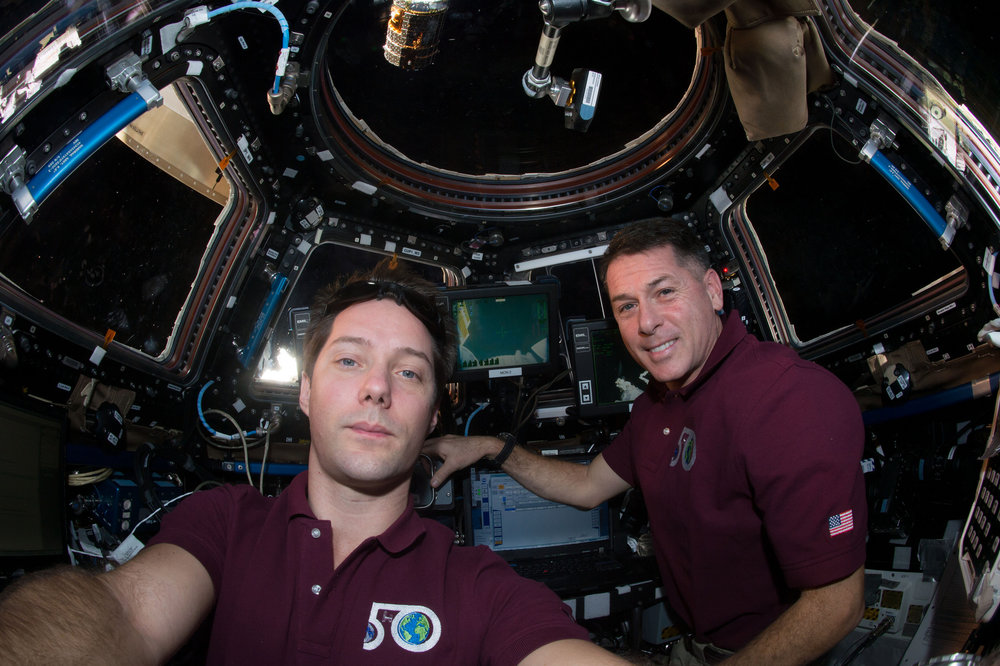 Expedition 50 Commander Shane Kimbrough of NASA, right, and Flight Engineer Thomas Pesquet of ESA seen moments after the successful capture of Kounotori 6, top. Photo Credit: NASA