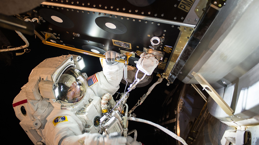 Jeff Williams is seen at PMA-2 during EVA-36 installing IDA-2. Photo Credit: Kate Rubins / NASA