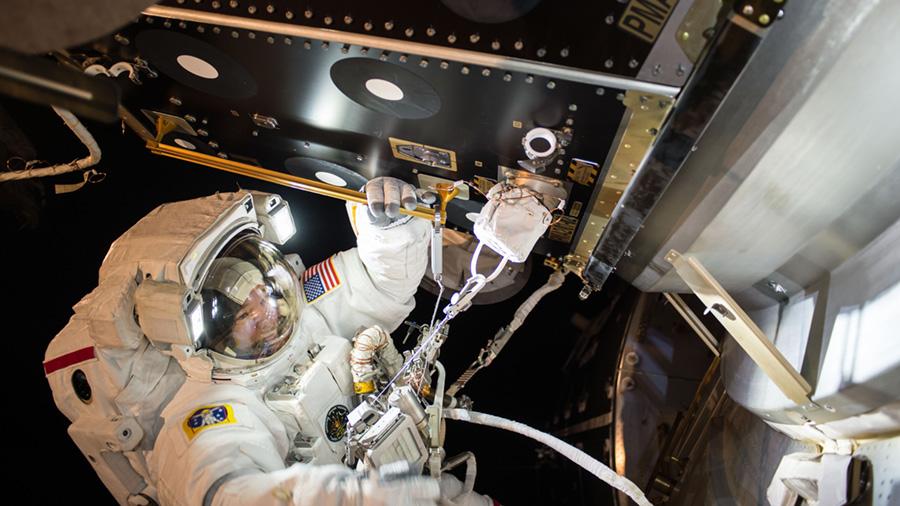 Jeff Williams is seen at PMA-2 during EVA-36 installing IDA-2. Photo Credit: Kate Rubins / NASA
