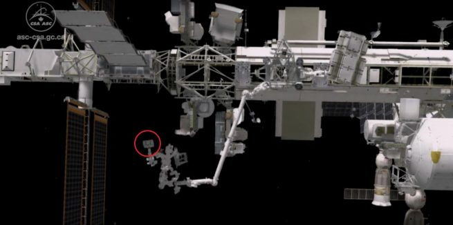 Using Dextre, ground-based robotics teams remotely swapped out nickel-hydrogen batteries with new lithium-ion units (red circle) connected to the station's 3A power channel. Image Credit: NASA TV