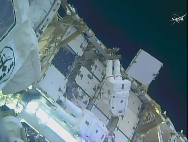 Kimbrough, top, and Whitson work to attach the adapter plates on the 3A power channel. Photo Credit: NASA TV