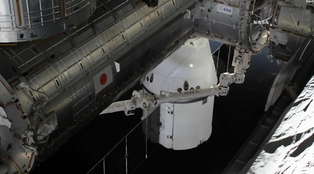 A view of Dragon just before berthing. This image wsa taken from a recently-installed high-definition camera on the space station's truss. Photo Credit: NASA