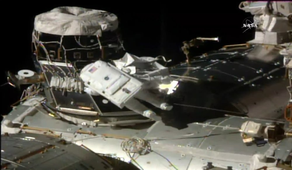 Astronauts Shane Kimbrough and Peggy Whitson work to remove the cover on PMA-3 during EVA-41 to prepare it for next year's arrival of IDA-3. Photo Credit: NASA TV