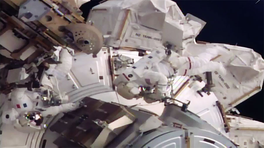 Shane Kimbrough, red stripes, and Thomas Pesquet finish up EVA-40 after spending more than six hours outside the International Space Station performing various tasks including disconnecting cables to allow for the relocation of PMA-3. Photo Credit: NASA TV