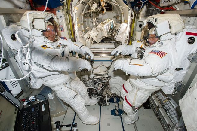 Jack Fischer (left) and Peggy Whitson are suited up for EVA-42, their previous spacewalk, which occurred on May 12, 2017. Photo Credit: NASA Read more at http://www.spaceflightinsider.com/missions/iss/astronauts-perform-contingency-spacewalk-replace-failed-data-relay-box/#y8igKcKYFv731Ojk.99