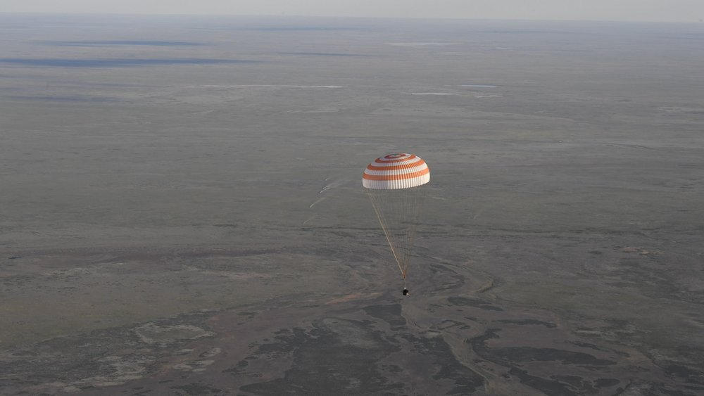 A Soyuz MS capsule descends toward the ground at the Kazakh Steppe. Two members of the Expedition 51 crew returned to Earth on June 2, 2017. Photo Credit: ESA