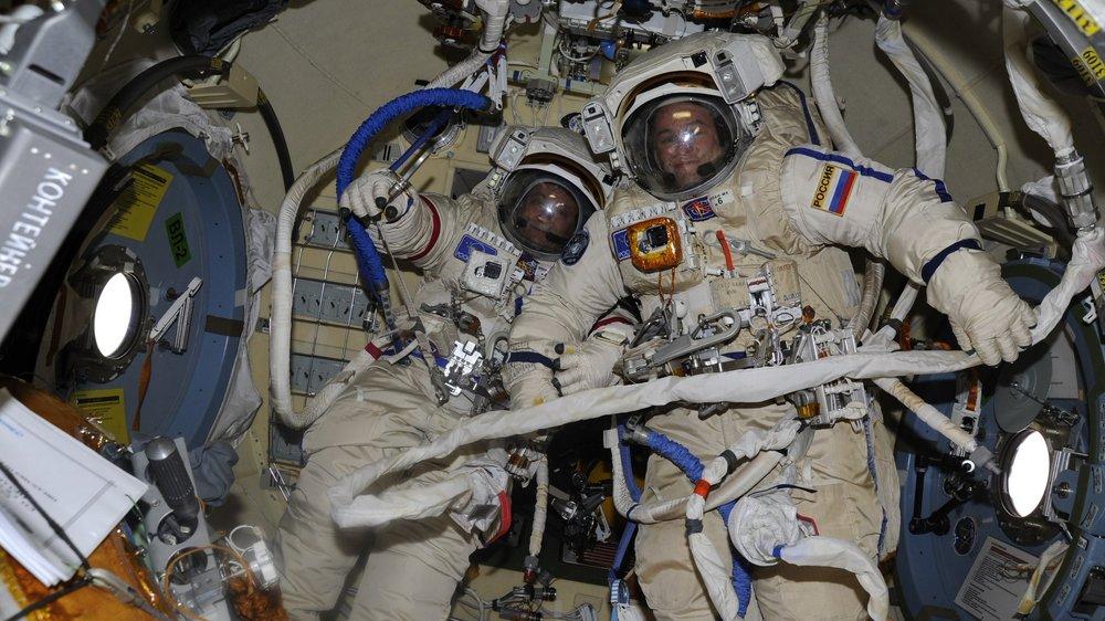 Expedition 52 Commander Fyodor Yurchikhin, left, and Flight Engineer Sergey Ryazanskiy in their  Orlan  spacesuits before their spacewalk. Photo Credit: Roscosmos