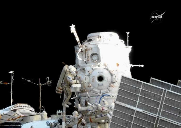 Fyodor Yurchikhin and Sergey Ryazanskiy gather around  Pirs near the end of their spacewalk. Photo Credit: NASA