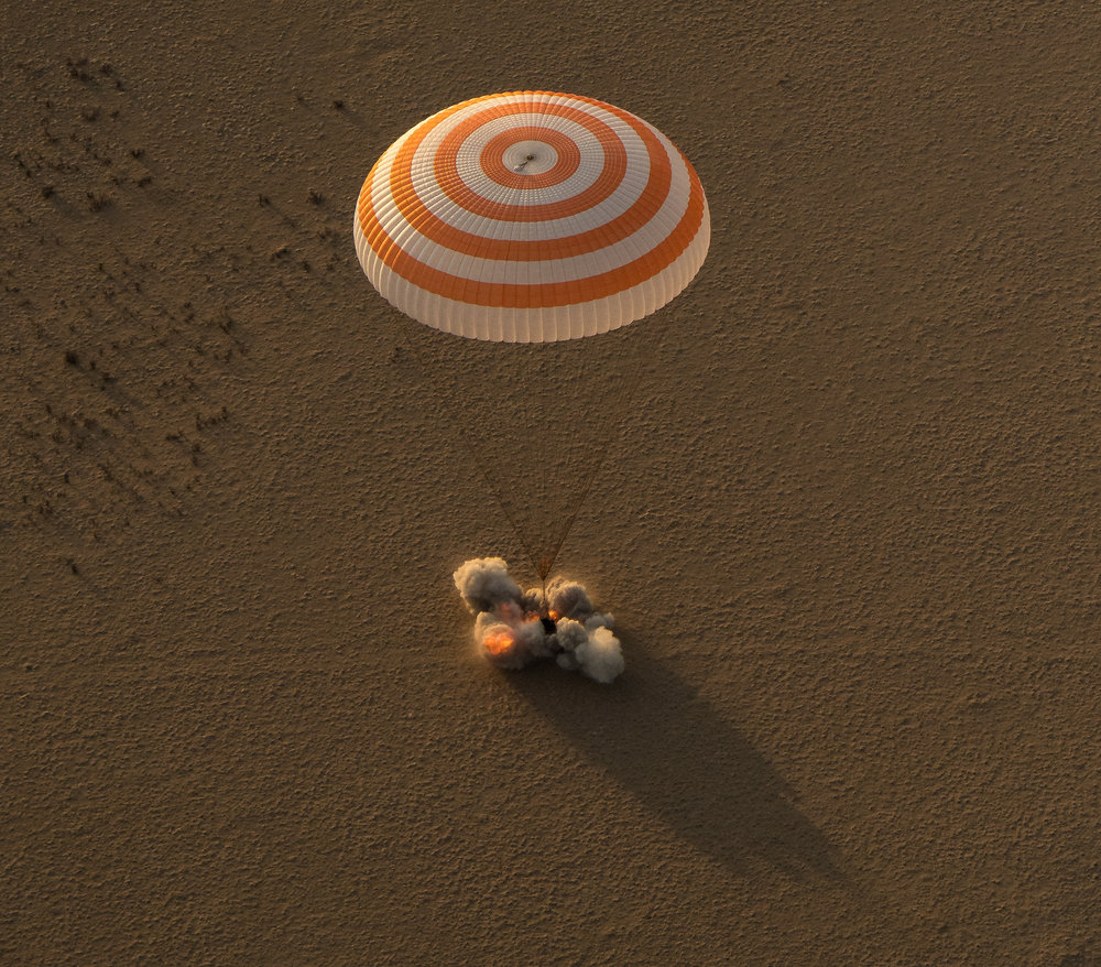The Soyuz's Soft Landing engines fire to cushion the capsule's impact with the ground. Photo Credit: Bill Ingalls / NASA
