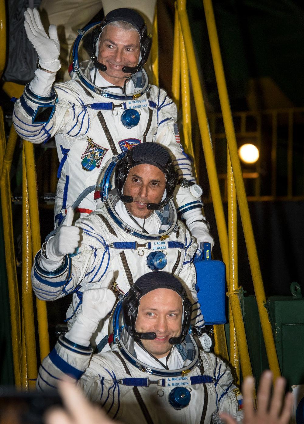 NASA astronauts Mark Vande Hei, top, and Joe Acaba, bottom, along with Russian cosmonaut Alexander Misurkin before boarding the Soyuz spacecraft. Photo Credit: Bill Ingalls / NASA