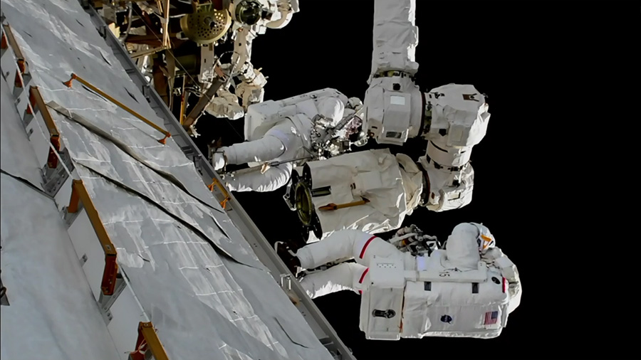 NASA astronauts Randy Bresnik, bottom, and Mark Vande Hei work to replace a Latching End Effector for the station's robotic arm. Photo Credit: NASA