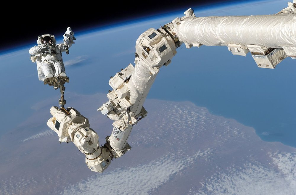 Astronaut Stephen Robinson at the end of  Canadarm2  during STS-114 in 2005. Photo Credit: NASA